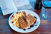 Steak with potato fries — Stock Photo