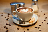 Cappuccino with cookie — Stock Photo