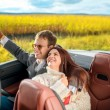 Happy couple in the car — Stock Photo