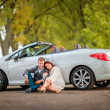 Happy couple near the car — Stock Photo