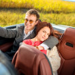 Happy couple in the car — Stock Photo #33493115