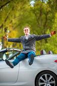 Man in white car — Stock Photo