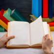 Reading book on white table with another color books on backgrou — Stok fotoğraf