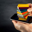Putting or download colorful books to the smart phone — Stock Photo #41049711
