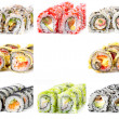 Eight different sushi rolls isolated on white background — Stock Photo #42777033