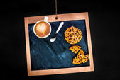 Coffee latte and oatcake on chalkboard — Stok fotoğraf