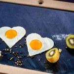 Breakfast with eggs, cheese, kiwi and orange juice on chalkboard — Stock Photo #43106733
