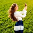 Young and happy woman getting message on the phone on the green — Stock Photo