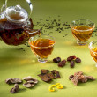 transparent teapot and glasses with tea and oriental sweets on  — Stock Photo #44085523