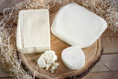 Cottage cheese on wooden desk with hay on background — Foto de Stock