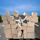 Business man breaking the wall of carton boxes on the road — Foto Stock