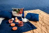 Romantic dinner on terrace near the water — Foto de Stock