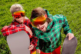 Couple in ski suit and sun glasses have a funny look to the came — Stok fotoğraf