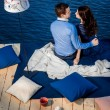 Young couple in love relaxing on terrace near water — Stock Photo