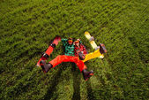 Couple in sportswear with snowboards lying on the grass — Stok fotoğraf