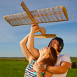 Girl and guy and model of airplane — Stock Photo