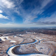 Forest of plain and small river in winter — Stock Photo #33519919
