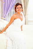 Bride on bed — Stock Photo