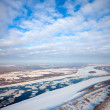 Spring of drifting of ice on the great river — Stock Photo