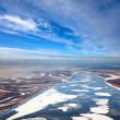 Great river with floating ice floes — Stock Photo