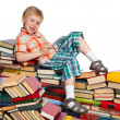 Little boy on a pile of books — Stock Photo #33520457