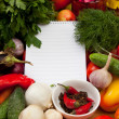 Notebook paper to write recipes and vegetables — Stock Photo #33520523