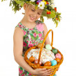 Small girl with hat of flowers — Stock Photo