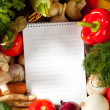 Notebook paper to write recipes and vegetables — Stock Photo #33520771