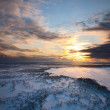 Sunset above frozen lake — Stockfoto