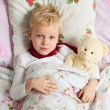 Sick boy is in bed — Stock Photo