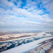 Spring of drifting of ice on great river — Stock Photo #33521657