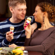 Girl and boy eating ice cream in the coffee — Stockfoto