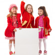 Girls in red are holding white billboard — Stock Photo