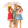 Barefoot children under an umbrella — Stock Photo #33522011
