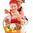 Girl and boy with Easter eggs and a holiday cake — Stock Photo