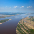 Aerial view the river on green forest plain.. — Stock Photo