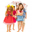 Barefoot children under an umbrella — Stock Photo #33522317