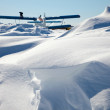 Stock Photo: Biplane parked on snow drifts