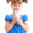 Smiling girl with a glass of milk — Stock Photo