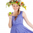 Beautiful girl with flowers and apple — Stock Photo