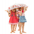 Stock Photo: Barefoot children under an umbrella