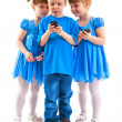 Two girls and a boy with their cell phones — Stock Photo