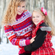 Mother and her daughter in park in winter — Stock Photo