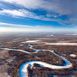 Forest of plain and small river in winter — Stock Photo #33523901