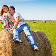 Guy and girl resting on the meadow. — Stock Photo