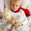 Sick boy is in bed — Stockfoto