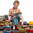 Little boy on a pile of books — Stock Photo #33524161