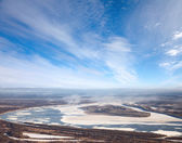 Great river with floating ice — Stock Photo