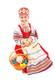 Girl with Easter eggs and a holiday cake — Stock fotografie
