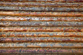 Wall of wooden logs — Stock Photo